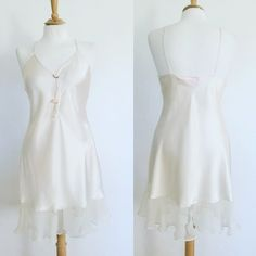 Vintage 80s Cream Babydoll Lingerie Nightie Here is a vintage 80s Babydoll nightie. Cream colored. Baby rose detail in peach. Tag reads Honors Intimates. Size Large. Measurements: Bust 38 in. / Waist 38 in. / Hips 42 in / Length 36 in Intimates & Sleepwear Chemises & Slips