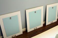 IHeart Organizing: Basement Progress: Playroom Art Display -- painted cabinet doors with clips screwed in! Displaying Kids Artwork, Artwork Display, Diy Artwork, Old Cabinet Doors, Old Cabinets, Playroom Art, Painted Doors, Painting Cabinets, Kid Spaces