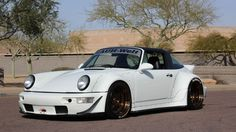 The air-cooled Porsche market is bonkers, with pristine examples going for big money. But if you prefer something with a bit more flair and, well, big ass flares, then this 1991 Carrera 2 Targa by RWB is for you.