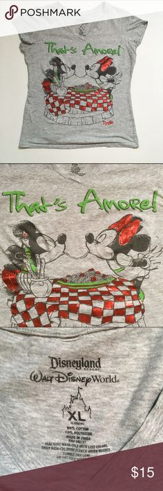 Disney World Mickey & Minnie Italy shirt This super cute gray shirt from Disney World's Epcot features Mickey Mouse and Minnie Mouse sharing spaghetti just like Lady & The Tramp. Soft and lightweight material, the picture has a distressed/antique look. The size says XL, and so I think it may be a kid's XL and fits a Ladies size Sm-Med. Previously loved, but it is still in good condition with no apparent flaws and lots of life left! 10% of proceeds go to a local nonprofit organization! My…