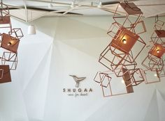 Seeing from the outside through the glass wall, there is polygon installation hanging around the front that is inspired from sugar crystals.