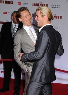 Tom Hiddleston and Chris Hemsworth attend 'Iron Man 3' World Premiere held at the El Capitan Theatre on April 24, 2013
