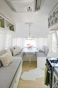 "Making the most of a small space (i.e. what looks like a camp trailer) in style! Can you imagine camping in this posh, gray and white ""wilderness"" pad?!"