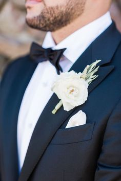 White Floral and Rosemary Groom's Boutonniere // navy suit, black bow tie, pocket square, groomsmen, wedding party, wedding attire
