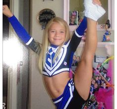 Carly Manning, #Cheer Athletics, heel stretch, (working on boards...will probably move one of the other cheer boards) Via:  http://lifeofacheerleader.tumblr.com/post/33375547807/cheer-athletics-cheetahs-little-carly-so-cute #KyFun