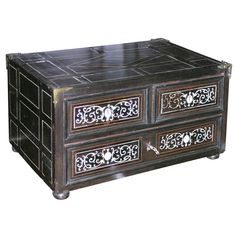Handsome 17th century Indo-Portuguese table-top chest having two short over one long drawer, ebony veneer with bone inlay, the top and sides with geometric inlay, the drawers with scrollwork designs.