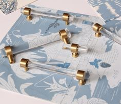 Sleek and functional pulls made from lucite and solid brass. Fabulous fit for cabinets, drawers, and any furniture. Pulls consist of 2 polished brass