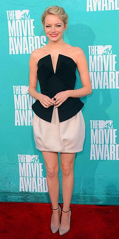 Emma Stone-hair and makeup are fantastic. love the color contrast and peplum. beautiful ankle-strap heals