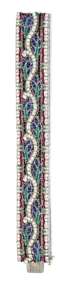 COLORED STONE AND DIAMOND BRACELET, VAN CLEEF & ARPELS, FRENCH, CIRCA 1930. Old European-cut diamonds weighing approximately 11.25 carats, further decorated with buff-top sapphires, rubies, emeralds and onyx, mounted in platinum, length 7¼ inches, signed Van Cleef-Arpels, numbered 24649, maker's mark, French assay mark. With signed box.