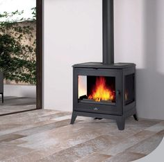 Bronpi Bury 3 Sided Multifuel Stove - brought to you by The Marble Warehouse. Stunning wood burning stove with 3 viewing windows. Cast iron interior, top or rear outlet, clean glass system. Stove Installation, Multi Fuel Stove, Wood Storage Box, Stove Fireplace, Fireplace Ideas, Wood Burner, Fireplace Surrounds, Large Windows, Ovens