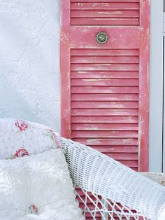 Pink Shutter!  Salvage Chic Outdoors!  http://www.bhg.com/decorating/room/decks/antique-porch-decor/#page=11  #outdoor #pink #shutter #porch #spaces #living #shabby #chic