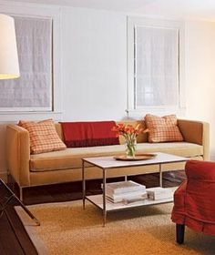 Modern living room with tan sofa and bright lighting   Surprising, low-cost ways to update your home décor.