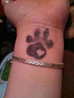 """Linkin Tobias Rios - my amazing black shih tzu. This is Toby's left paw on my left wrist.  Everybody said """"don't get a tattoo on your wrist"""" I DONT REGRET IT ONE BIT."""