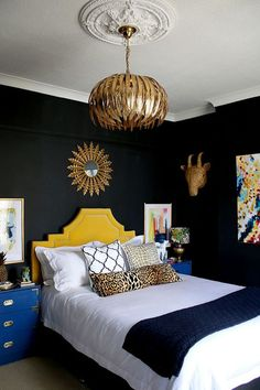 black bedroom with gold light fixture, yellow headboard and colourful artwork… Bedroom Color Schemes, Bedroom Colors, Home Decor Bedroom, Bedroom Ideas, Bedroom Apartment, Bedroom Wall, Bedroom Furniture, Furniture Sets, Yellow Headboard