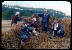 Farmer taking refreshment in a rice field  Enami Studio Lantern Slide No : 567.  About 1920's, Japan