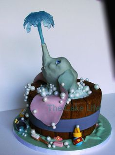 dumbo baby shower cake By The Cake Life. I have always loved Dumbo but this one is especially adorable with the Isomalt water spouting out of his trunk.