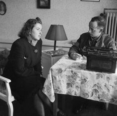 A sergeant from British Field Security Police interrogates Clara Lackman, a typist at the Gestapo Headquarters in Lubeck.