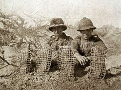 British troops in the desert wear make-shift sandshoes.