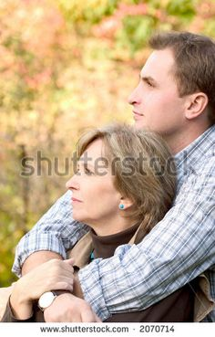 Adult son hugging his mother