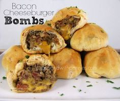 Bacon Cheeseburger Bombs! Recipe with lean ground beef, onions, bacon, cream cheese, ketchup, barbecue sauce, yellow mustard, worcestershire sauce, egg whites, Pillsbury Biscuits, cheddar cheese