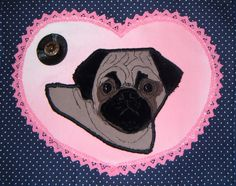 Portrait of my Pug Lilly, done in applique with a mix of machine and hand sewing. It looks just like her, as I based it on a drawing I did of her. I'm putting it on a cushion eventually!