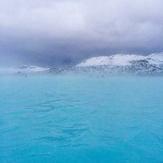 A snowstorm approaches the Blue Lagoon hot spring in #Iceland. #gradient    Photo courtesy of brianthio on Instagram.