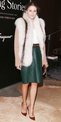 Palermo looked fall-ready in a fur vest layered over a knitted top and a belted forest-green leather knee-length skirt. A metallic faceted clutch and caramel-colored Christian Louboutins completed her look.