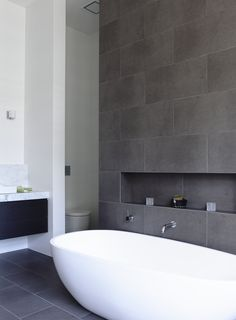 Feature Wall Tiles Bathroom Awesome Seven Things Every Chic Bathroom Has Pivotec. Feature Wall Til Grey Bathroom Tiles, Bathroom Renos, Laundry In Bathroom, Modern Bathroom, Small Bathroom, Grey Tiles, Wall Tiles, Bathroom Ideas, Shower Ideas