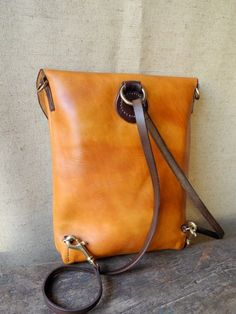 orange leather backpack with brown straps