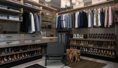 His side of the master closet includes U shelves for dress shirt storage, matching faux marble counter top with sitting arrangement and slanted shoe shelves. #ClosetFactory