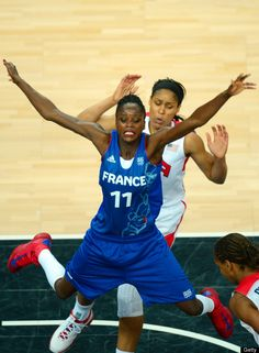 French guard Emilie Gomis (front) is challenged by US guard Maya Moore  Gold Medal Match