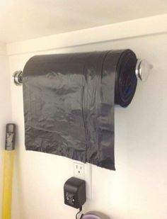 Great idea! Hang garbage bags on paper towel holder in pantry or cleaning closet.