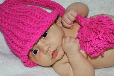 My baby girl wearing a hat I loom knit.  Please vote for her http://apps.stjosephmedia.com/contest/gallery/gallerydetail.php?id=887=camilia-smiles-contest