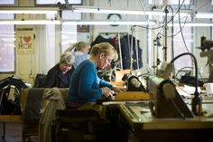 Workers hand making garments at Cooper & Stonebrand textile factory, Salford Manchester