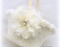 ***Made Upon Request This flower girl basket and ring bearer pillow set can be made in ANY color scheme.  This listing is for 1 ring bearer pillow and the matching flower girl basket.  Stunning ring bearer pillow and flower girl basket set in romantic shades of ivory and lilac. Crafted to perfection, this pair will the talk of your wedding.  The pillow is 8x8 inches, the basket is 8 inches tall (including the pearl handle). The opening is 6 inches wide. The basket can be made taller upon…