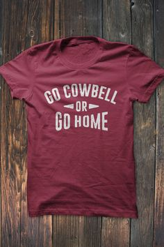 Mississippi State Fans, Show off your school pride in this Go Cowbell or Go Home T-Shirt. Available in white distressed print on maroon t-shirt  Our shirts are printed on Bella + Canvas shirts. #bourbonandboots