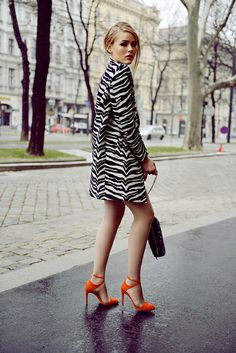 zebra print coat + orange pumps.