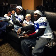 Dez Bryant playing video games with a guest at a local children's hospital #DallasCowboys