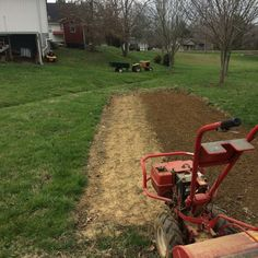 Narrow garden spot with good soil beside our storm drainage ditch in the sunnyview neighborhood of eastern Knox county in Tennessee. Tiller. John Deere.