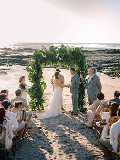 A dramatic palm frond arch, a Costa Rican jungle hut, all white bridesmaid dresses... this intimate beach wedding is a tropical bohemian mood. We adore the laidback energy of the day, as evidenced so beautifully in the Golden Hour newlywed portraits by the ocean, her loose open back gown flowing romantically in the wind. See this Costa Rica micro wedding in full on the blog! Floral Backdrop, Backdrop Ideas, Ceremony Backdrop, Wedding Ceremony, Backdrops, White Bridesmaid Dresses, Brides And Bridesmaids, Protea Bouquet, Tropical Weddings