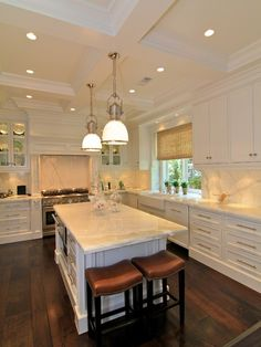 Prestige Mouldings  Construction: Stunning U shaped kitchen design with recessed lighting in coffered ceiling as well as ...