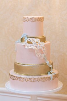 Pink and gold masquerade themed cake.  Elegantly Iced. Photography: Charlie Juliet - charlie-juliet.com