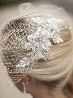 """Stunning one-of-a-kind handmade birdcage blusher wedding veil has elegant Swarovski crystal lace and sparkling crystal french net edging. This stunning bridal veil is highlighted by a sumptuous dazzling crystal lace applique 10"""" across and 3"""" w. The lace is layered with 3-dimensional crystal flowers for a true work of art. This breathtaking crystal lace (imported from Europe) is guaranteed to turn heads as you walk down the aisle."""