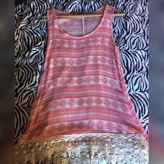 Cute lace bottom tank Worn once, excellent condition, no rips. Comes to about mid thigh and has lace on the bottom. Eye catcher for sure! Tops Tank Tops