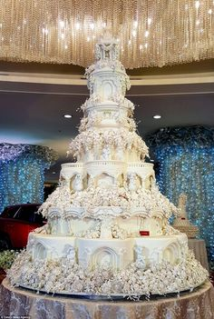 A cake like this one which features seven enormous tiers and hundreds of individual sugar flowers requires two trucks to move it to a venue