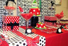 red and black ladybug first birthday party dessert table