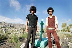 This is Cedric Bixler-Zavala (left) and Omar Rodriguez-Lopez (right), both of whom are superb dressers, at least in Mars Volta promo shots. Particularly like the colour of Omar's suit, and the flat cut at the bottom of the waistcoat. Sound Of Music, Listening To Music, Music Is Life, Live Music, My Music, The Mars Volta, Cedric Bixler Zavala, Omar Rodriguez Lopez, Danzig