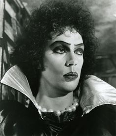 Dramatic portrait of Tim Curry as Dr. Frank-N-Furter, taken by Mick Rock. Description from pinterest.com. I searched for this on bing.com/images