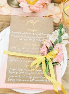 Pink and yellow place setting with white calligraphy on kraft menu | Vicki Grafton Photography | see more on: http://burnettsboards.com/2014/03/german-folktale-editorial/