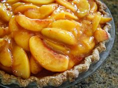 A perfect way to serve those tree-ripened peaches. The almond extract in the pie and the whipped cream makes it delish. We slurped up the whole pie in 12 minutes flat!